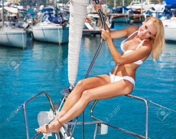 10993999-Happy-female-tourist-having-fun-on-sailboat-summertime-sailing-vacation-beautiful-woman-outdoor-sexy-Stock-Photo.jpg