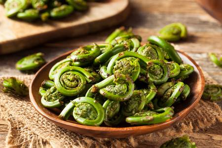 56709658-raw-organic-green-fiddlehead-ferns-ready-for-cooking.jpg