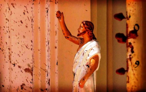 This photo taken at St. Sebastian's Church in Negombo is a snapshot of the horror that many experienced during this holy weekend. Blood stains are splattered across the walls and on a statue of Jesus Christ..jpg